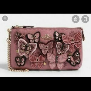 Coach wristlet with butterfly appliqué